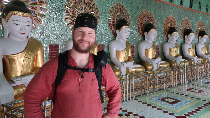 Inside Umin Thounzeh at Sagaing Hill, Myanmar, in front of the 30 Buddha statues.