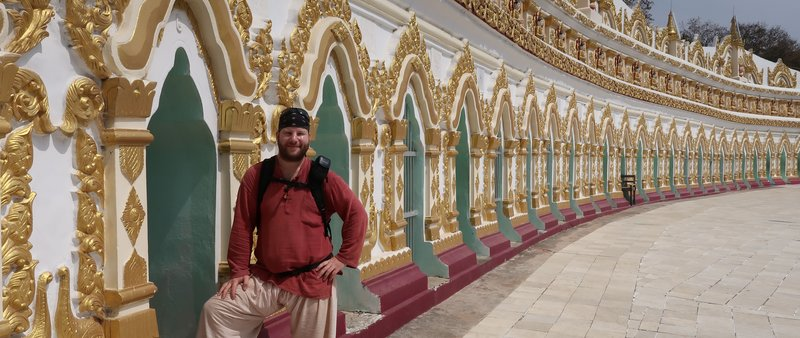 Outside Umin Thounzeh at Sagaing Hill, Myanmar. The Buddhas sit inside the arcades.