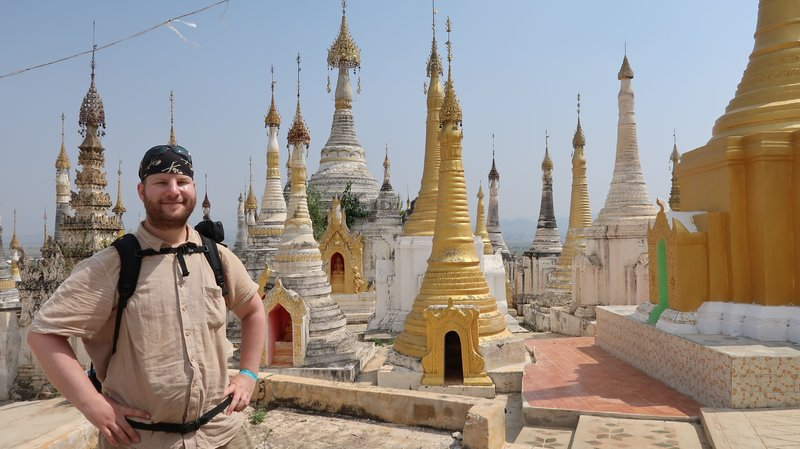 Another impressive view of the gold-and-white stupa towers of a typical pagoda at Inle Lake, Myanmar.