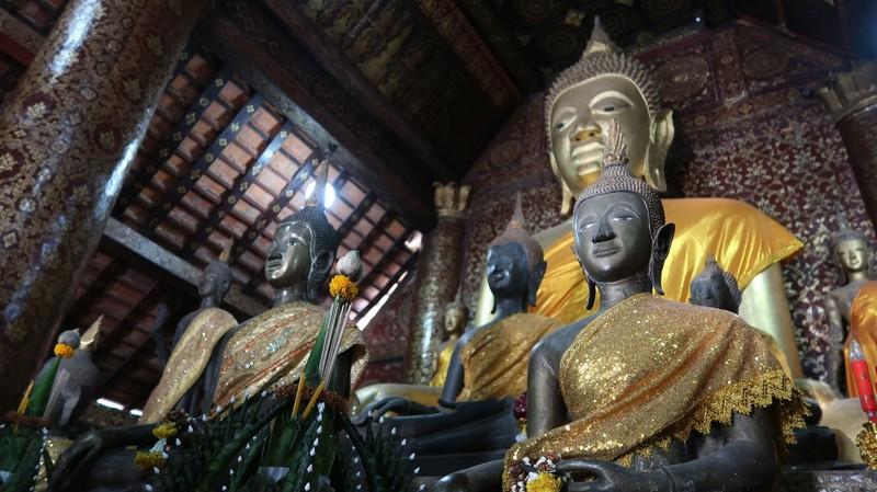 Buddhas in Wat Xieng Thong Buddhist Temple in Luang Prabang, Laos.