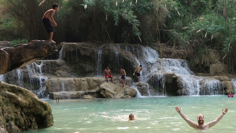 Swimming in one of the pools of Kuang Si waterfall, Laos.