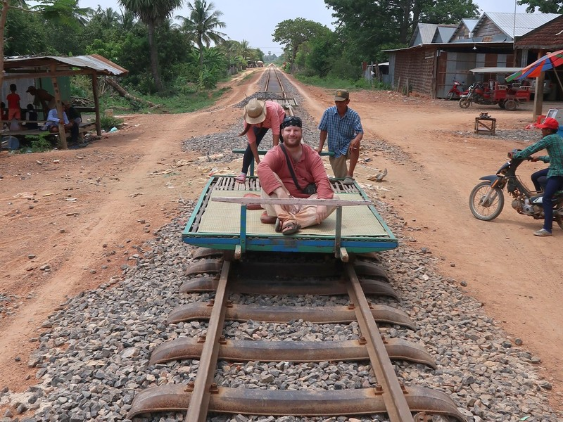 Riding the bamboo train in Battambang, Cambodia.