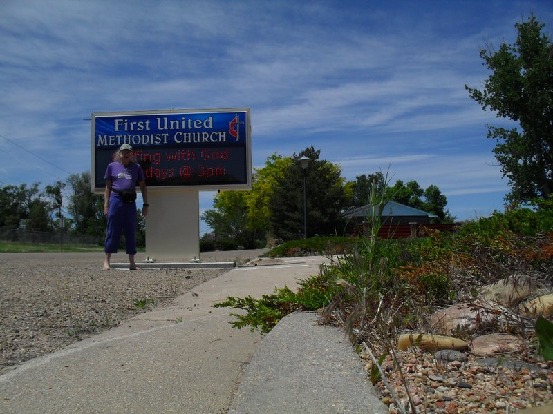 Me by the sign for the church I attended in Rocky Ford