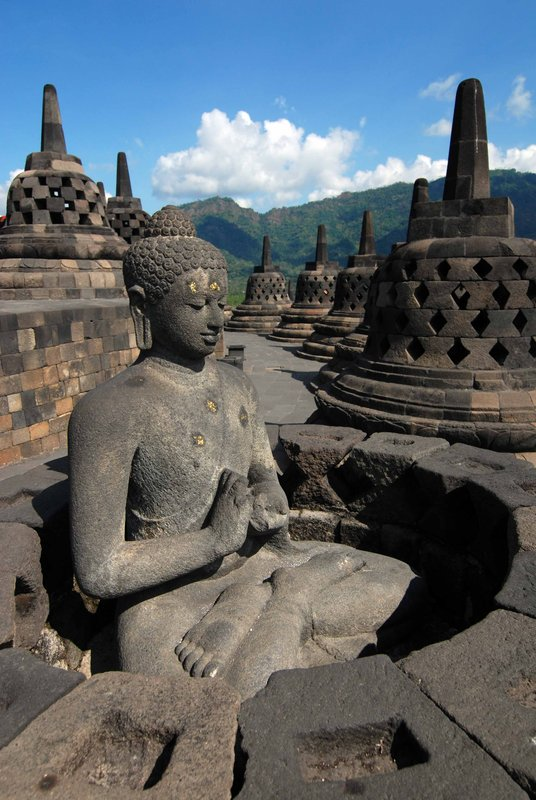 Buddha with stupas