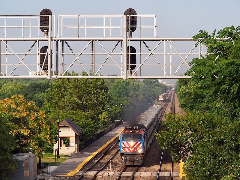 Metra Trains westbound pass Highlands station