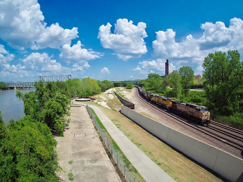 Union Pacific freight train along the banks of the Missouri river in Kansas City, MO