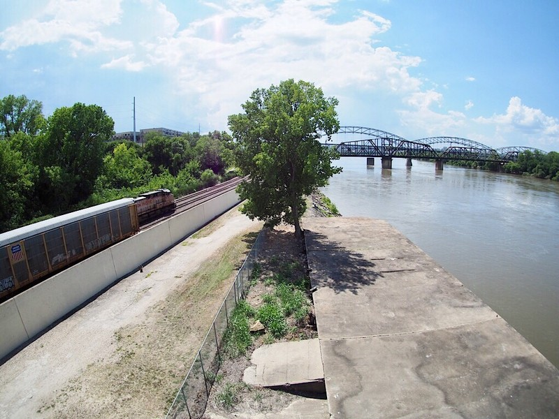 UP and BNSF trains cross at the banks of the Missouri river in Kansas City, MO