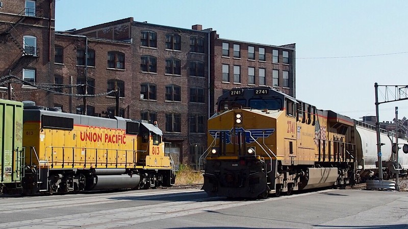 UP freight train passes local switcher at Kansas City West Bottoms