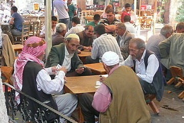 Men playing games at the tea room