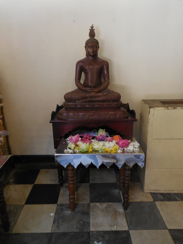 Buddha with offerings