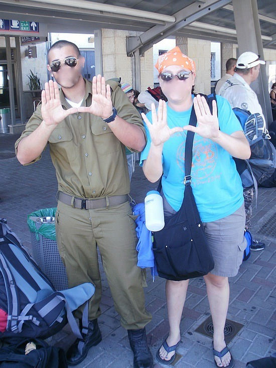 Making the U with a soldier