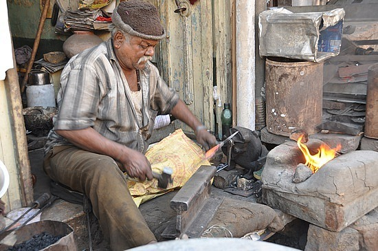 Blacksmith working in the street