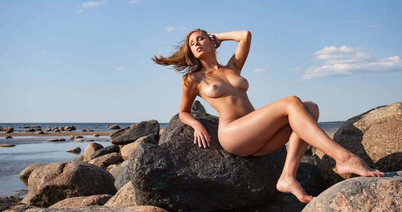 41625741 - beauty girl outdoors enjoying nature. beautiful young sexy nude woman by the sea. free happy woman