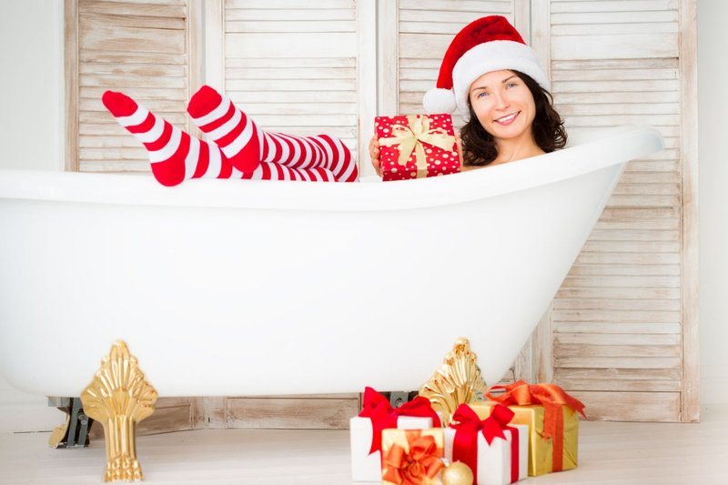 32862122 - santa girl having fun at home. christmas holiday concept