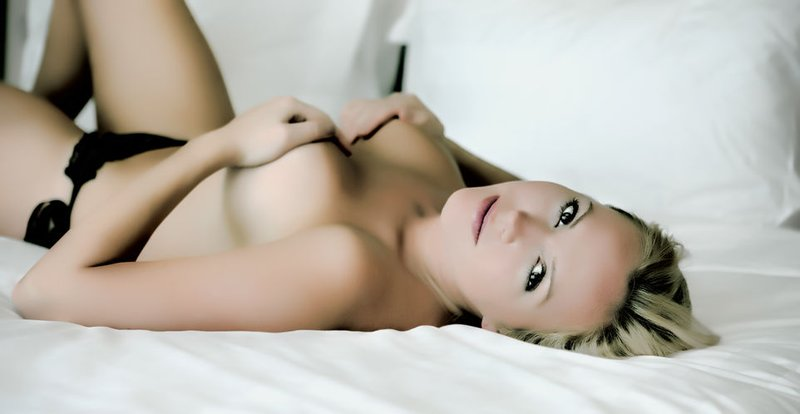 45095548 - young sexy blond woman on the bed