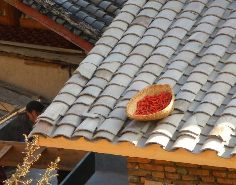 Zhongcha village - red chillies drying on a hot roof