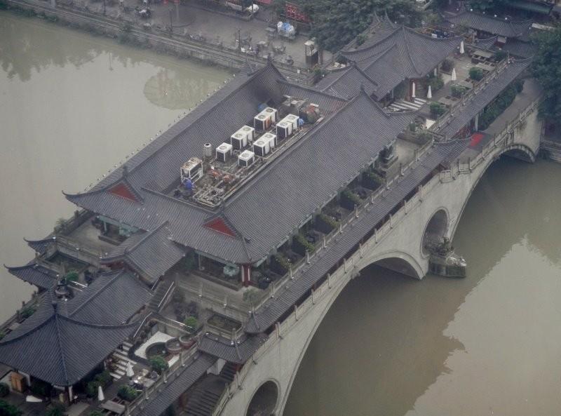 Chengdu - bridge over Jinjiang river with teahouses