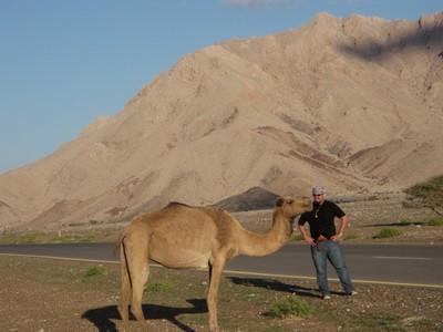 John checks out a camel along the road outside of Bat