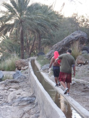 Naseeb and John follow the falaj back to our vehicle