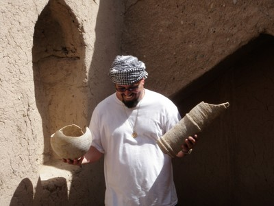 John investigates pottery at Al Sulaif