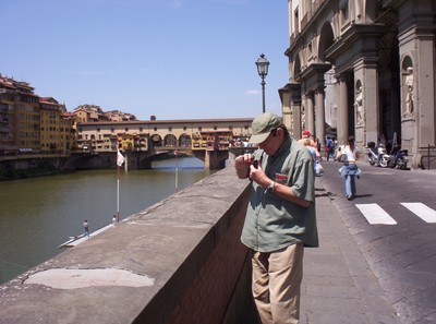 HISTORIC   FLORENCE  ITALY.--   Down  by  the  river  Arno ,with the  medieval Ponte  Vecchio  ,bridge.
