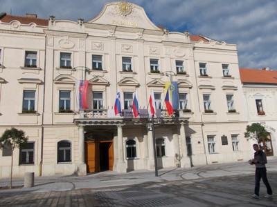 TRNAVA,  SLOVAKIA.   --  Town  Hall in  Trinity  Square.  --- Small  balcony supported  by Tuscany  Pillars.