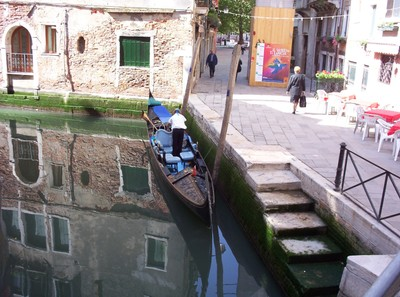 VENICE  ITALY.  Corner of a Canal with Gondola.