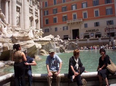 """ROME  ITALY. Trevi Fountain.  Tourists stand with their backs to the fountain,and throw a coin into the fountain ,making a wish. Mine came true because i""""ve been back to Rome twice."""