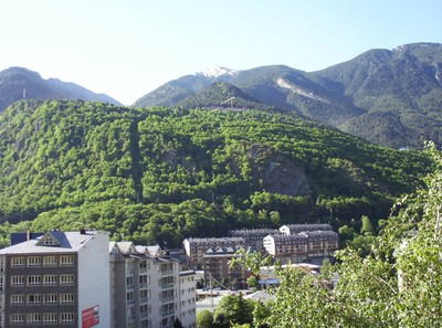 LA VELLA  ANDORRA.   Pyrenees  mountains tower above  town centre.