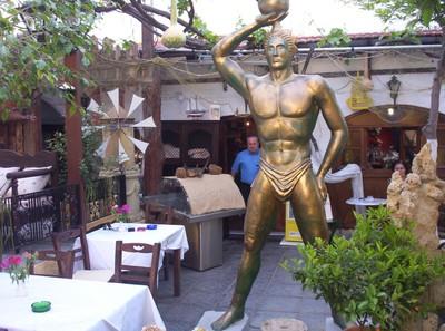 GREECE  RHODES..     Restuarant  ,Garden.   Their idea of the Colossus of Rhodes. !
