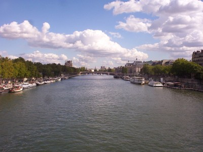 PARIS  FRANCE. --  River  Seine,  Notre  Damn  Cathedral  at  far  end  of  picture.