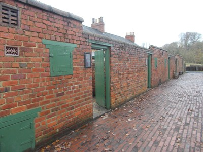 BEAMISH MUSEUM..Miners cottages back lane. The Little green door is for coal deliveries.