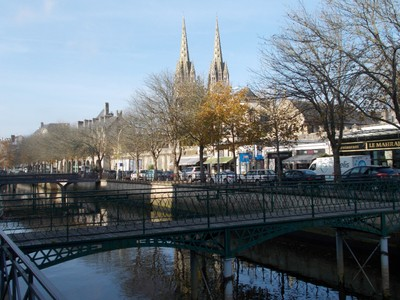 QUIMPER,  FRANCE.. Footbridges over the river Odet. in November.