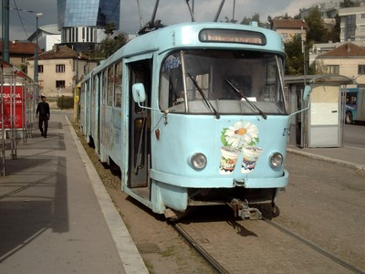 SARAJEVO.  Tram at  rail  station  stop.  I used  route  number 1 to  Bascasija  Square..  The  base of  Twist  tower  can  be  seen  in  picture.