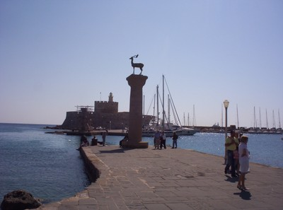 GREECE  RHODES.   .Fortress and Rhodian Deer. in Mandroki Harbour.