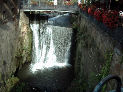 SAARBURG  GERMANY .  Waterfall in city centre.  The river Saar was diverted to flow through the centre of the city.