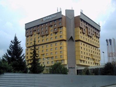 SARAJEVO. -- Holiday  Inn. Built  in  1982.      International news  reporters camped in  the  Holiday  Inn during  the Bosnian  War. --Now  hotel  called  Hotel  Holiday.