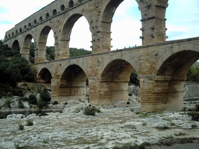 PONT DU  GARD,  AQUEDUCT.  The bottom  bridge,,  tourists can be  seen  walking.