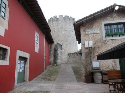 LLANES,  SPAIN.  --The circular limestone medieval tower.