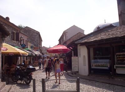 MOSTAR,  BOSNIA HERZEGOVINA..  Busy  cobbled  street.