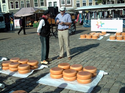 GOUDA  HOLLAND.   Is he checking  the price  ?