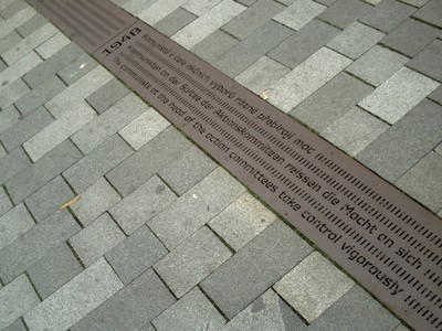 CHEB  CZECH.      Metal strip in centre of walkway, with historic facts in 3 languages. I found this very interesting, because i did not know anything about  Cheb.