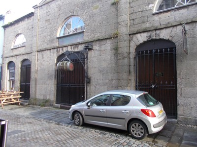 CAERNARFON  WALES UK  Old Market Hall,  now a Public Bar. Does the barrel drop on your head if you leave without paying ?