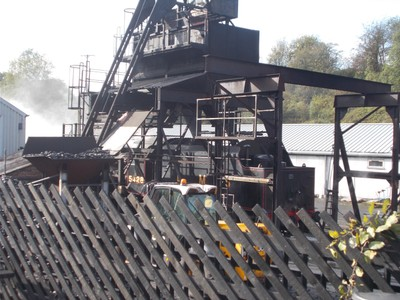 STEAM TRAIN LOADING COAL FROM TIPPER.