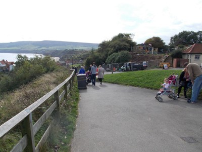 ROBIN HOODS BAY. At the top of hill, walk down steep hill, with lovely sandstone houses.