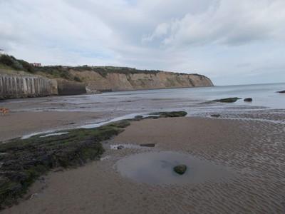 ROBIN HOODS BAY  Beach and cliffs.