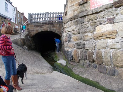 ROBIN HOODS BAY.  Tunnel of stream  that runs into the North Sea.  These tunnels were used in days gone by smugglers.