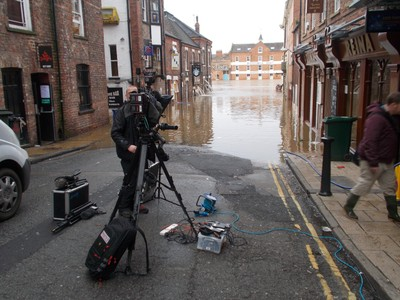 YORK,, TV crew and flood of river ouse
