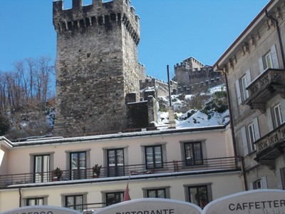 BELLINZONA , SWITZERLAND.   Castle wall above town centre.