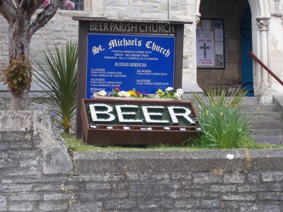 BEER DEVON.   Parish church of St, Michael. With the name Beer in white stones.
